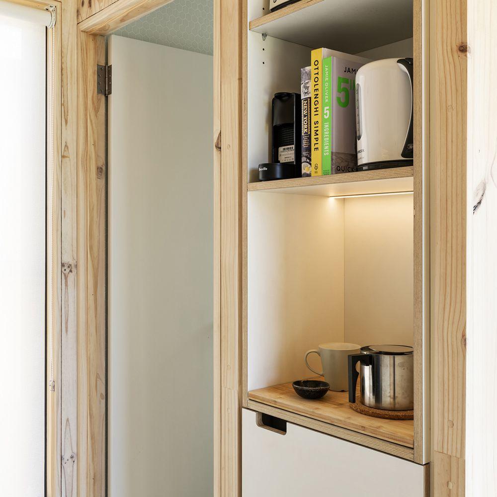 Shelves and storage next to an open door