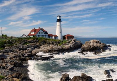 Portland Head Light in background with ragged rocks along the shoreline