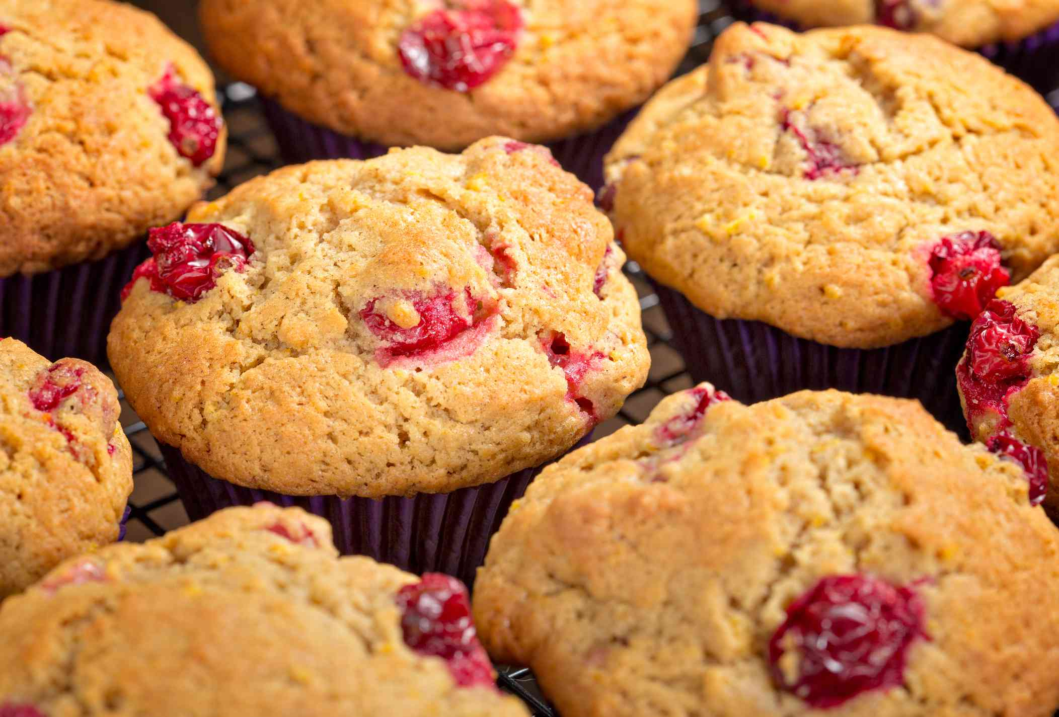 Close up of cranberry orange muffins on a cooling rack