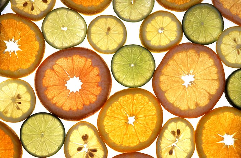 Slices of different forms of citrus fruits