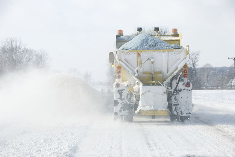 Snow plow applying road salt