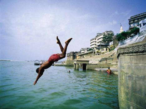 boy diving into ganges photo