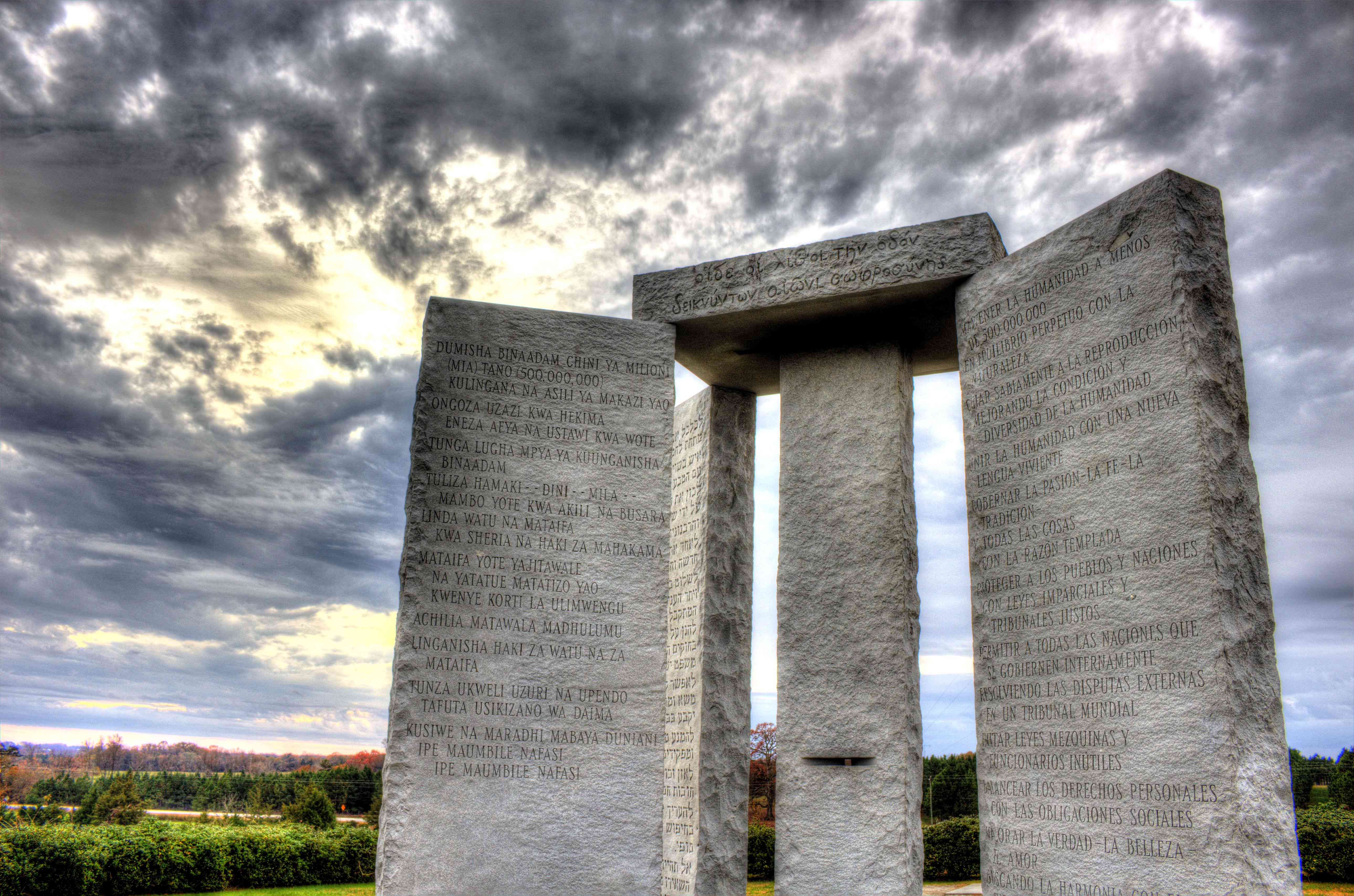 Tall granite monuments with writing inscribed at sunset