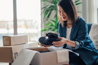 Woman opening box of shoes