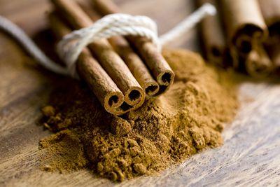 Ground cinnamon and a bunch of cinnamon sticks