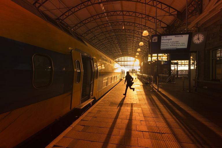 Man running to catch a train on Den Haag Hollands Spoor Train Station