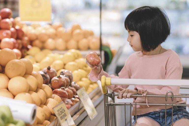 little girl in grocery cart