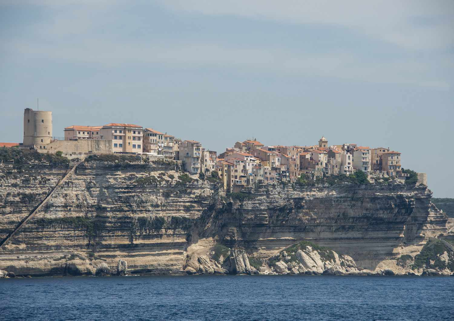 The ancient town of Bonifacio sits on the cliffs over the water