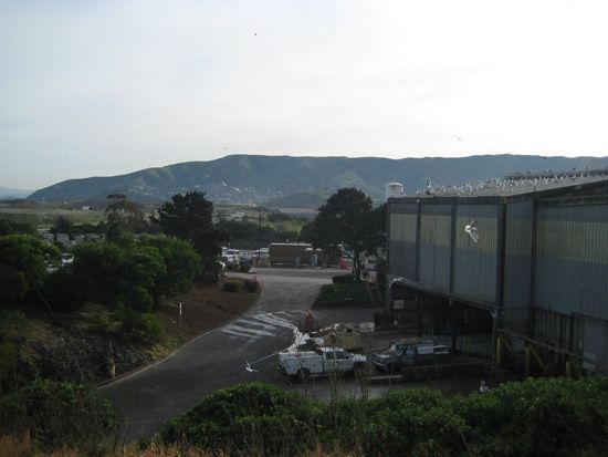 The exterior of the facility against a hill.