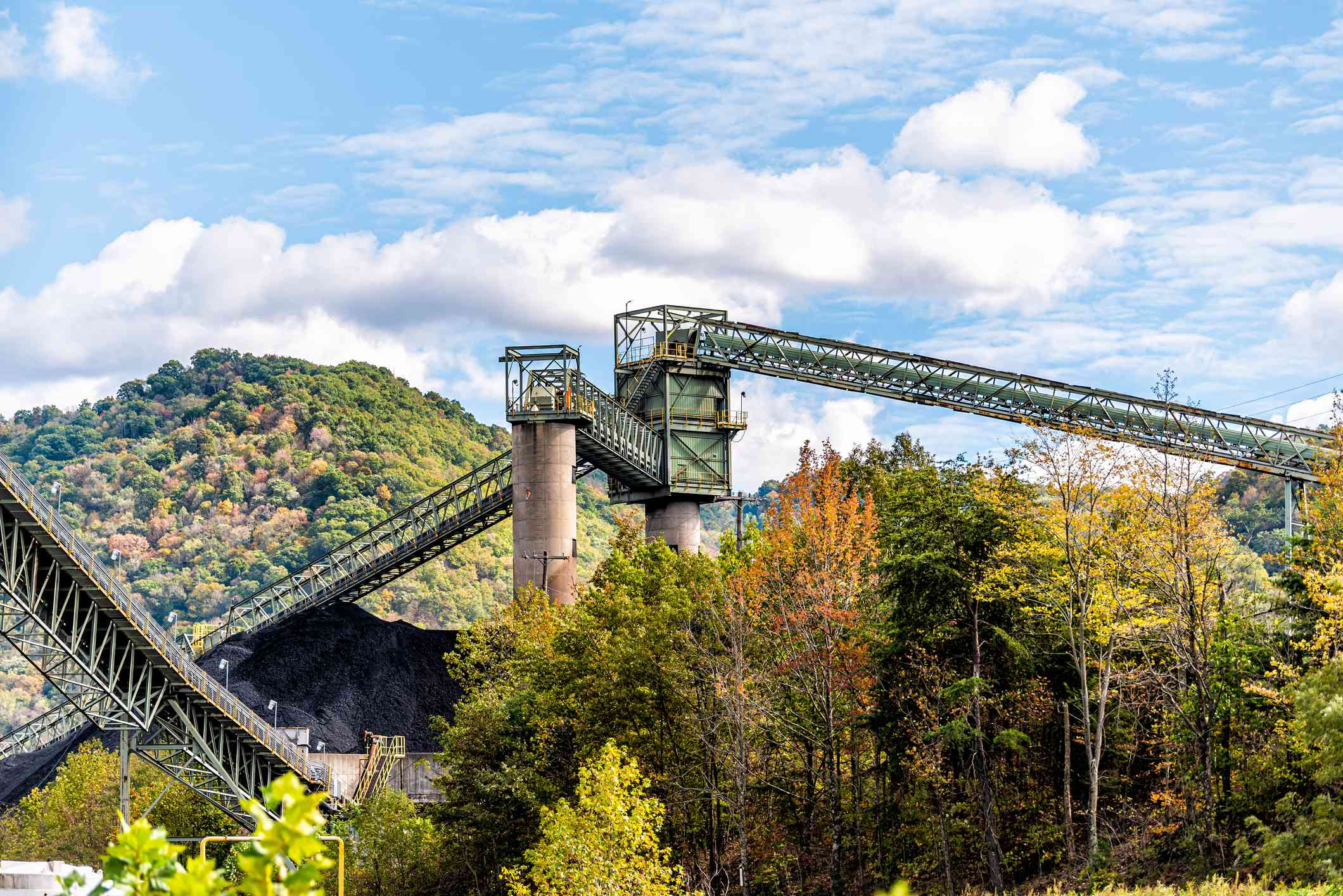 Charleston, West Virginia, USA city with industrial factory coal conveyor belt power plant exterior architecture with elevator lift