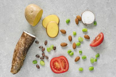 flat lay shot of poisonous foods we eat like potatoes tomatoes and cassava