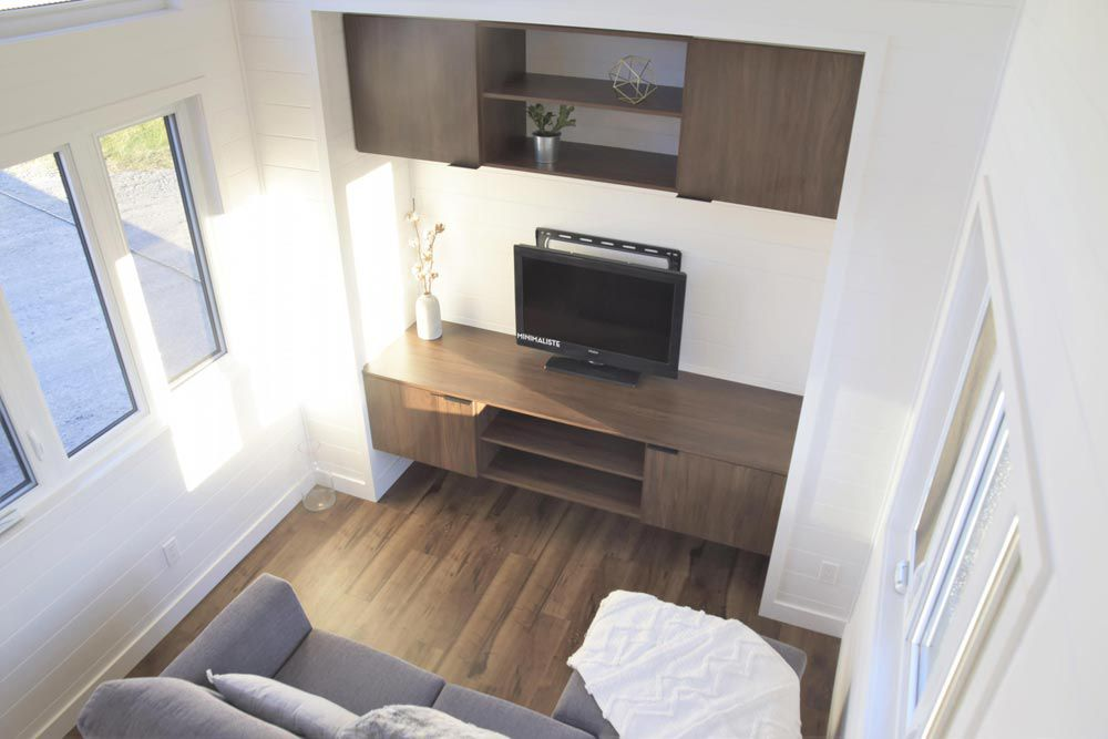 Overhead view of living space with an entertainment center and TV