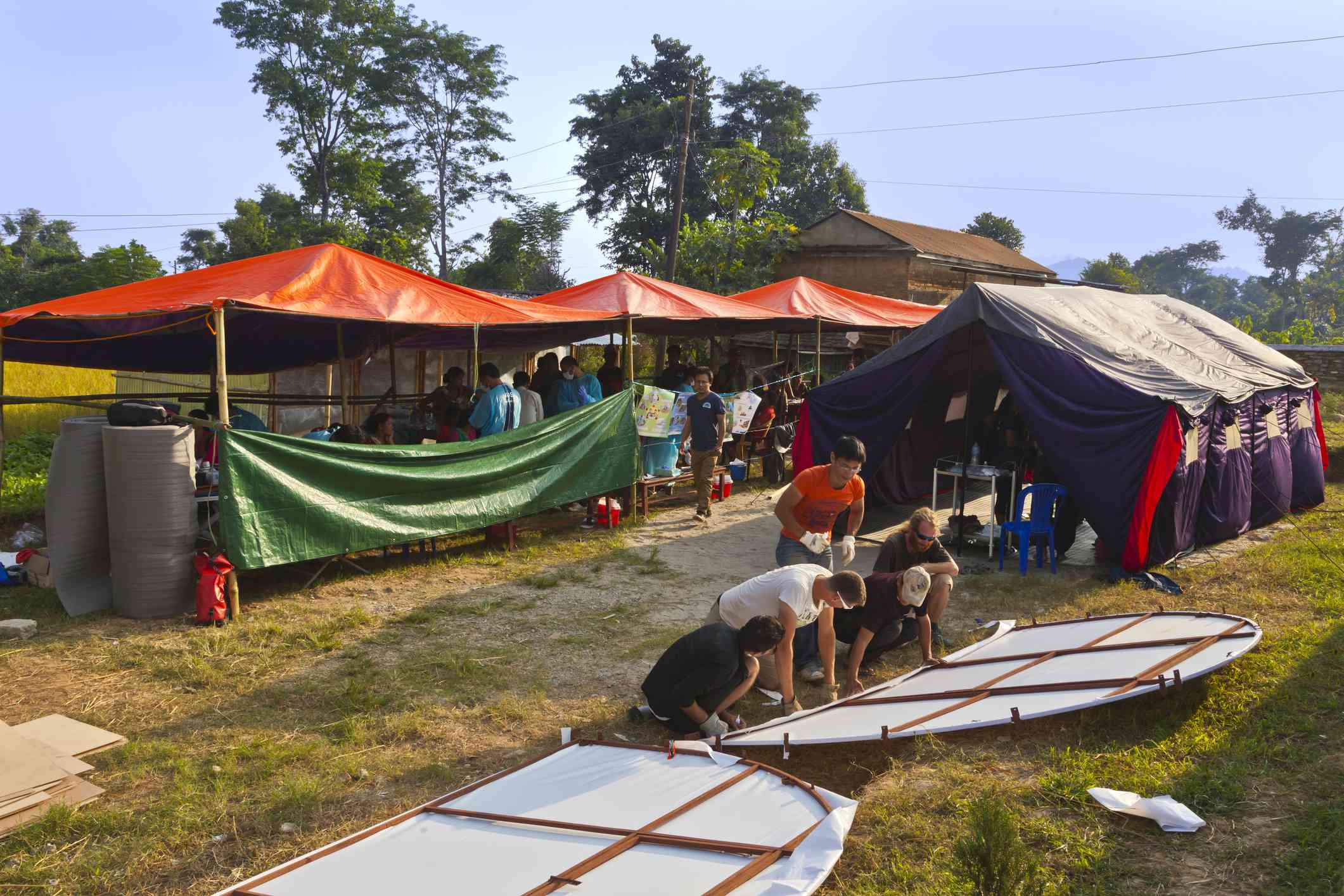 Volunteers set up a structure for medical services in Nepal