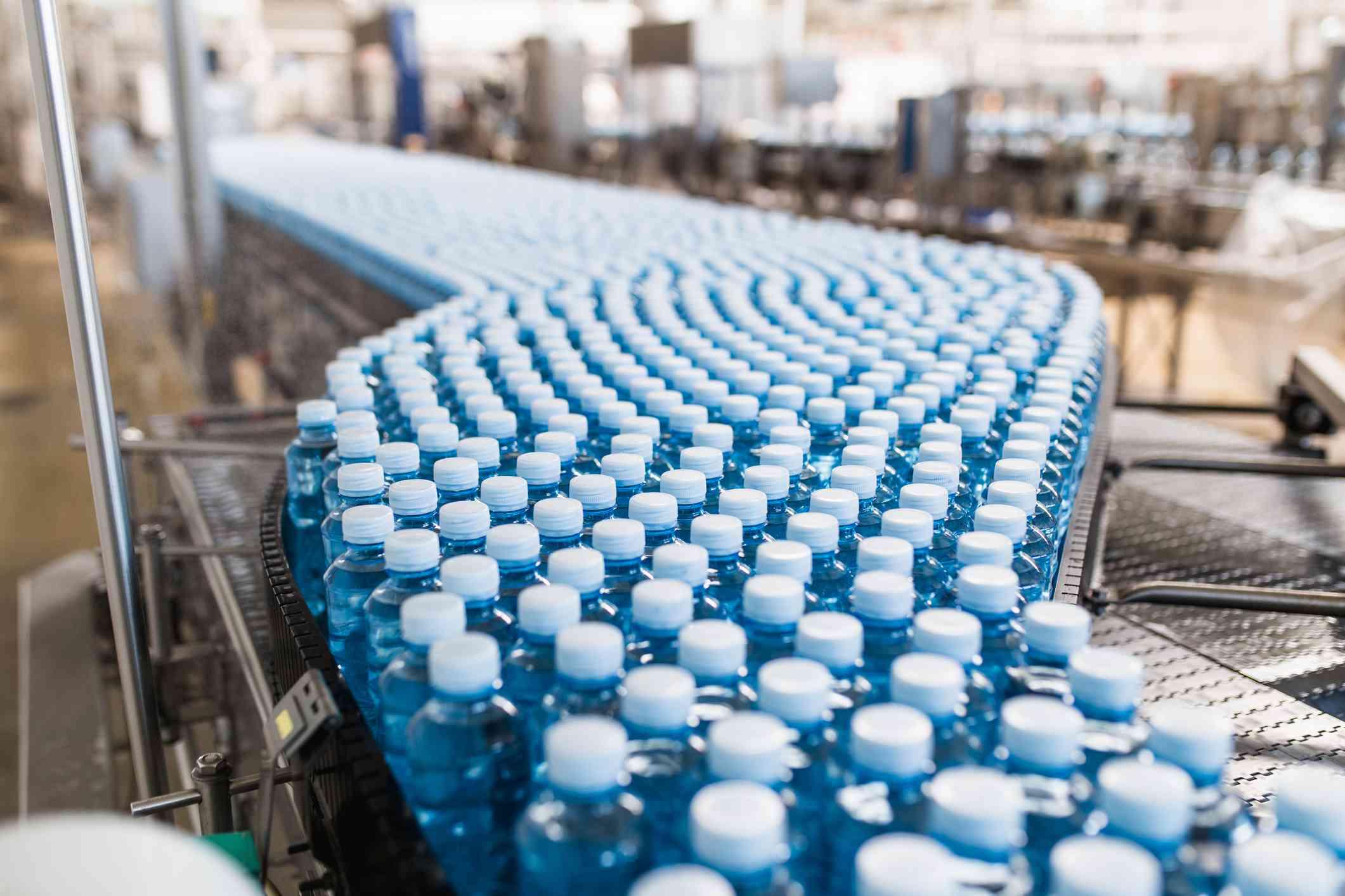 Plastic water bottles on a conveyor belt.