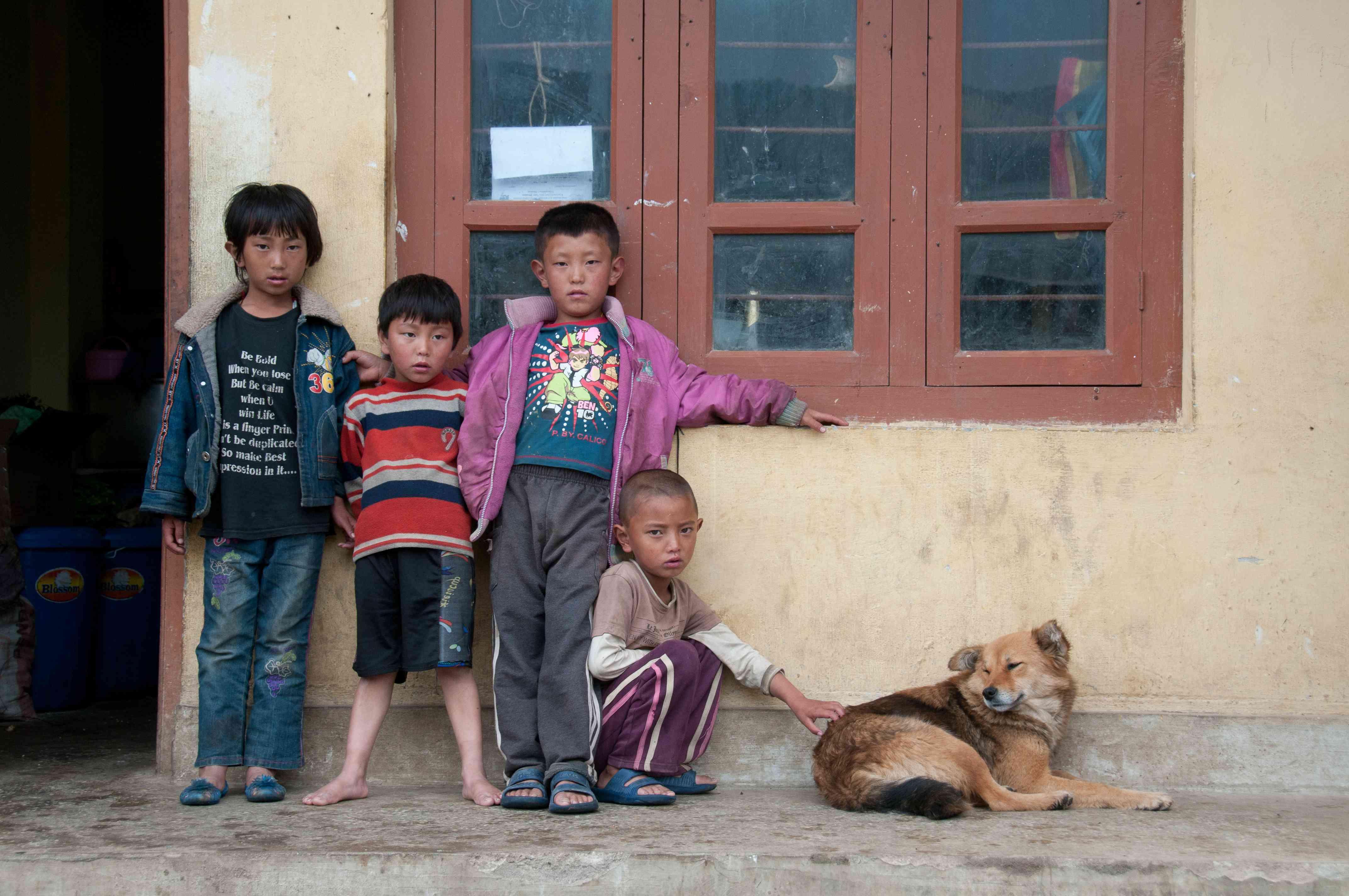 Street dog with children in Bhutan