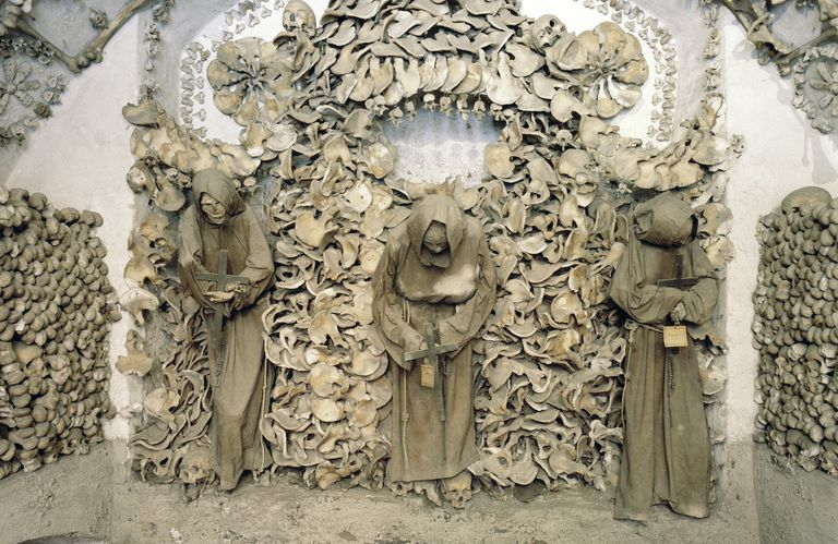 Bones and skulls of friars arranged ornately in the Capuchin Crypt in Italy