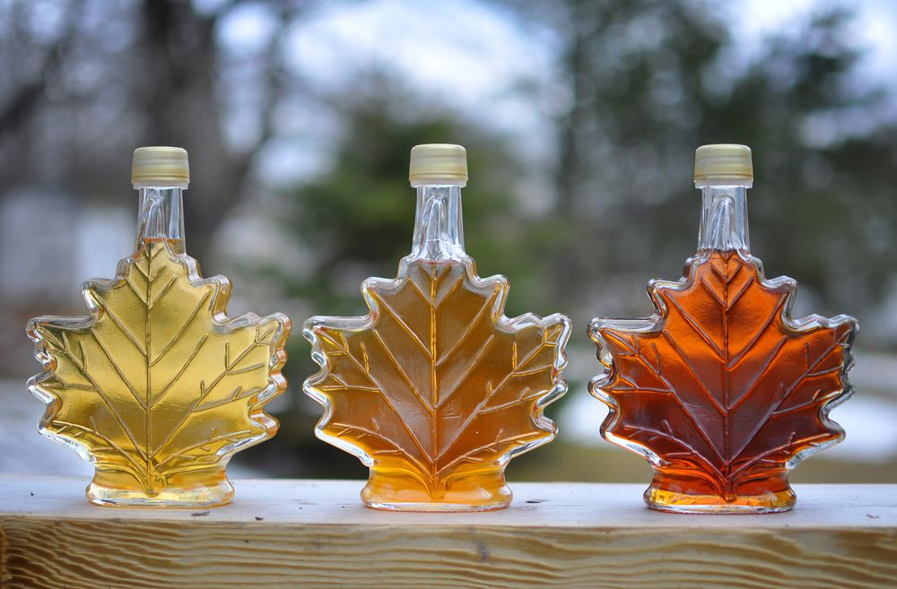 three bottles of Canadian maple syrup