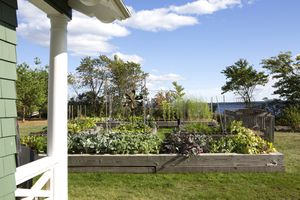 Well organized and maintained raised vegetable garden by the lake
