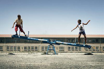 boys on a seesaw