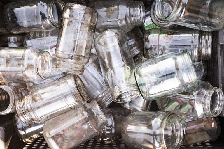 Pile of glass jars in a basket