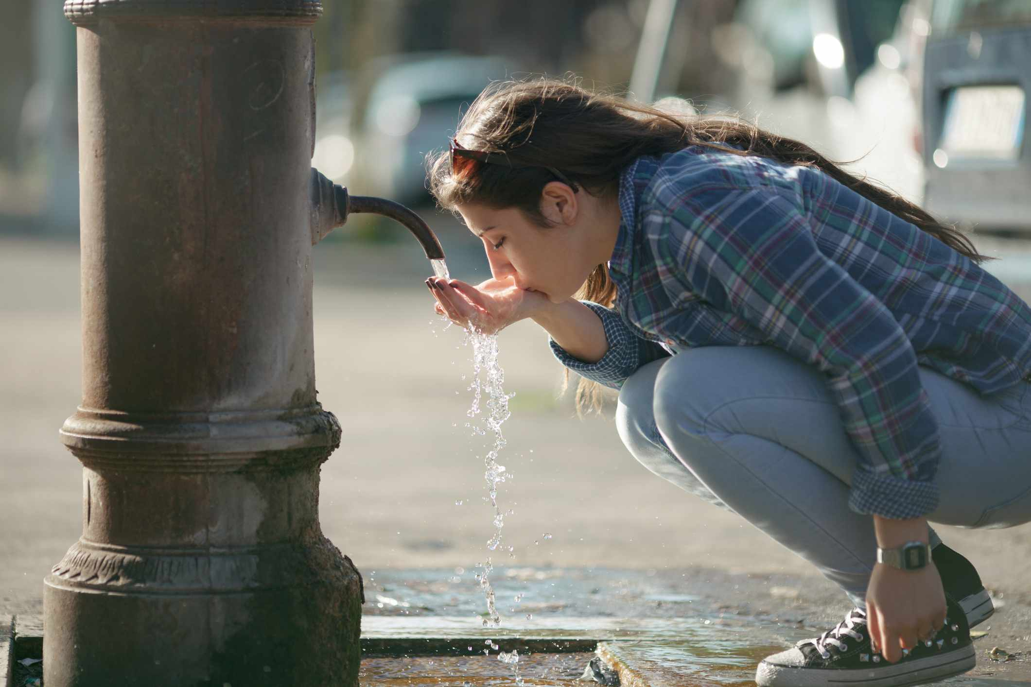 Young girl drinking water