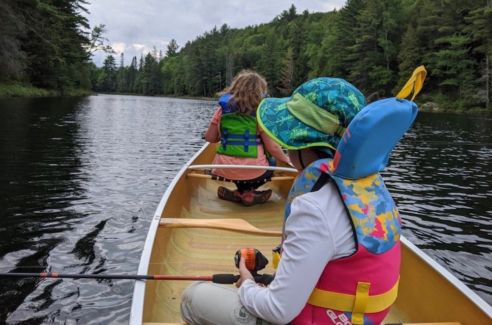 kids fishing in a canoe