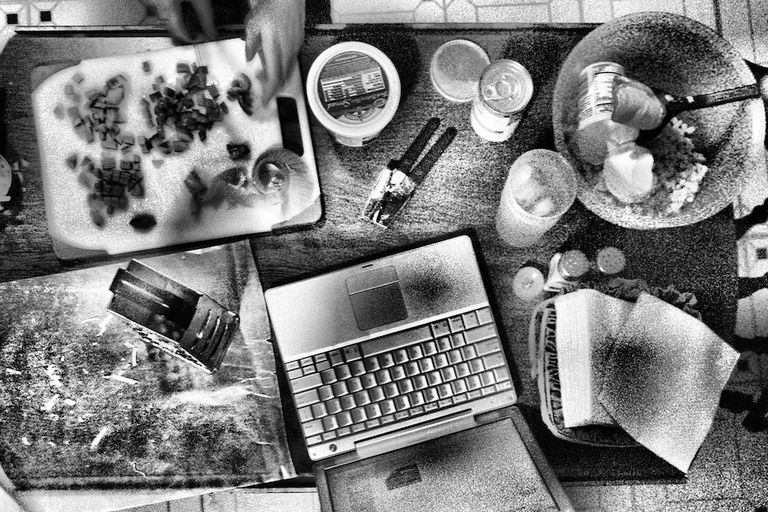 Kitchen prep table with a laptop showing the recipe