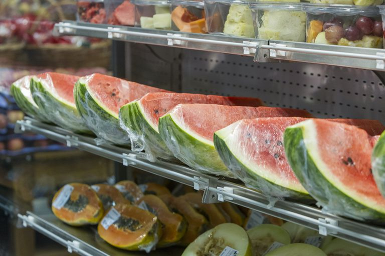 plastic-wrapped fruit on a shelf