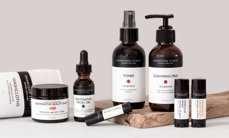 A skincare line that is stored in amber bottles.