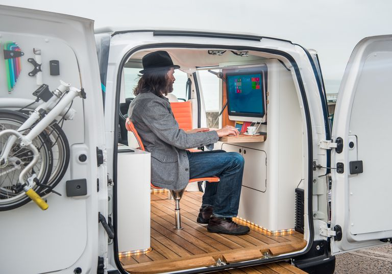 A man works in his Nissan mobile office.