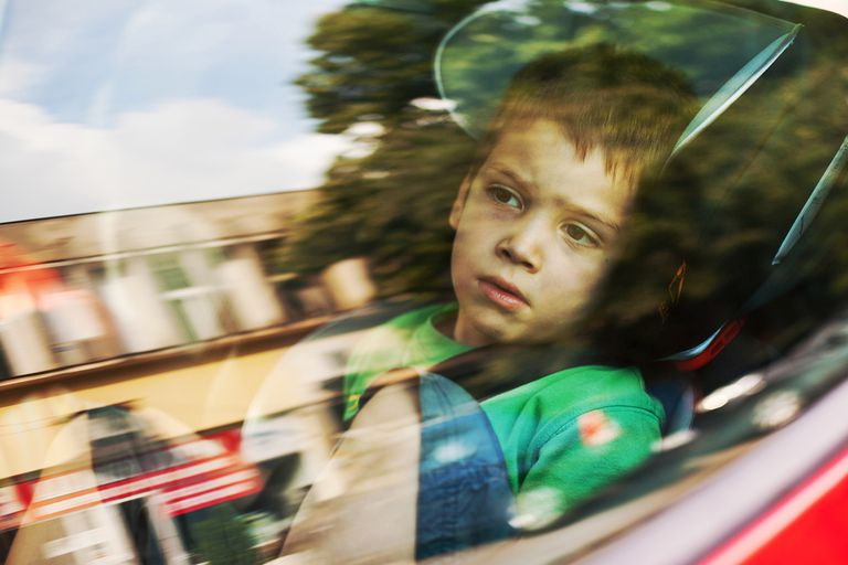 boy looking out car window