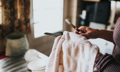 Cleaning silverware with dish towel