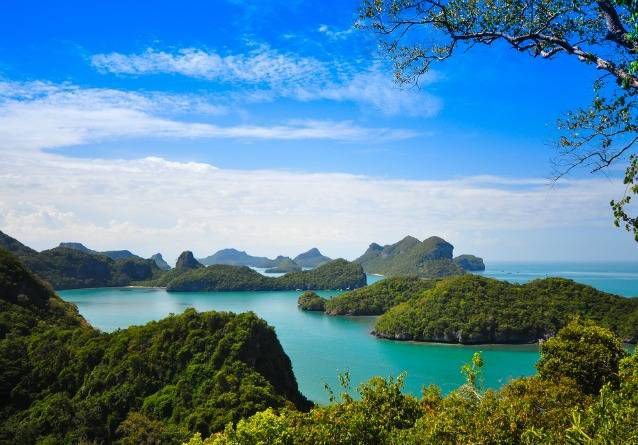 Beautiful blue lagoon surrounded by lush green islands under a blue sky