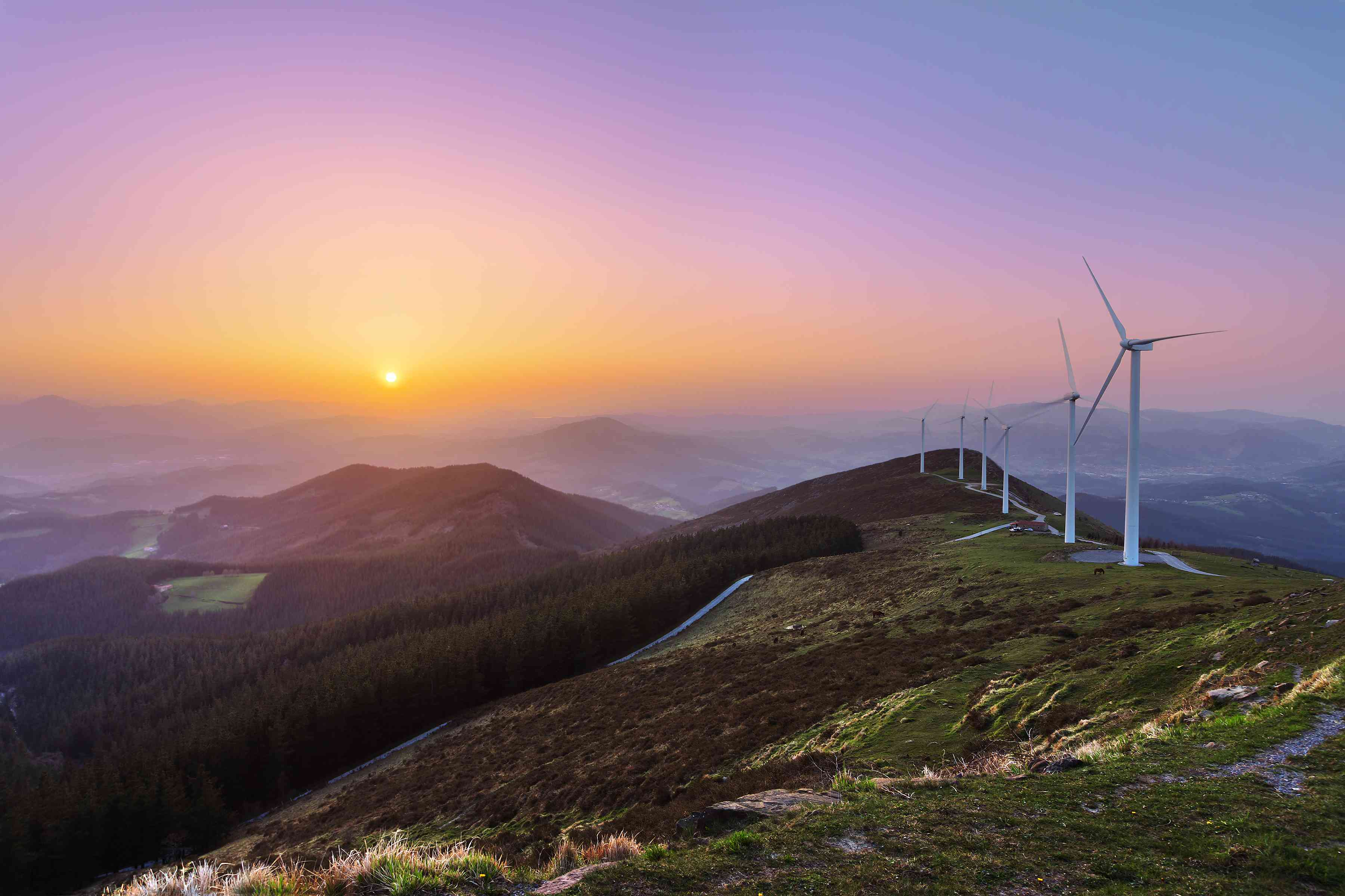 wind turbines at sunrise in Basque Mountains