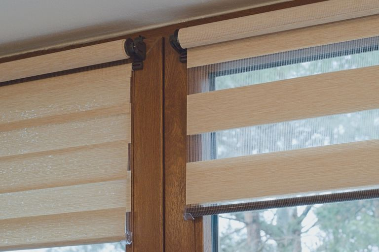 Neutral blind shades partly rolled down.