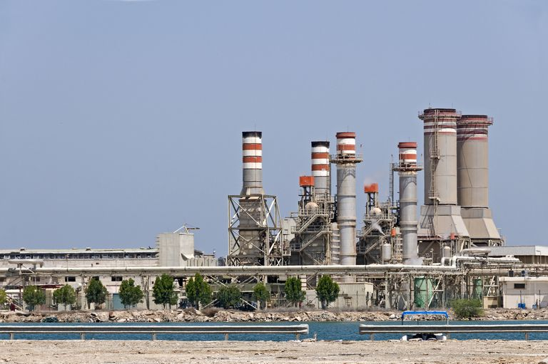 Exterior of a desalination plant with water in the foreground