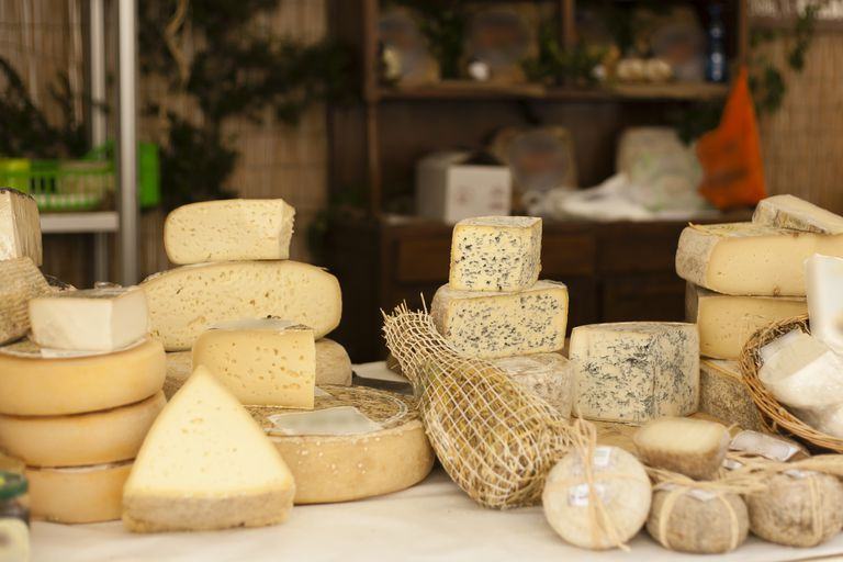 Cheeses on the counter at a market