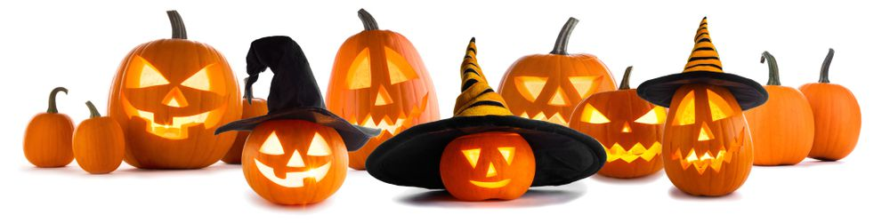 group of simple carved pumpkins with hats on some of them