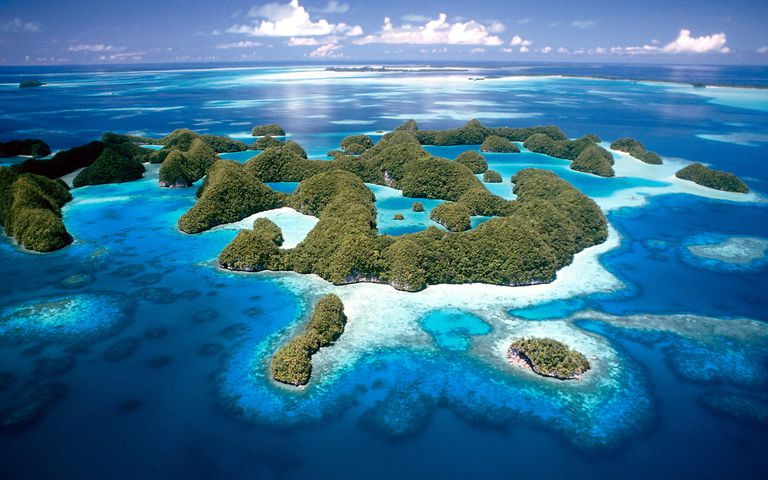 Jellyfish Lake, Palau with small green islands and various shades of blue water