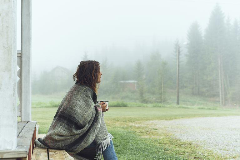 woman having coffee in a blanket