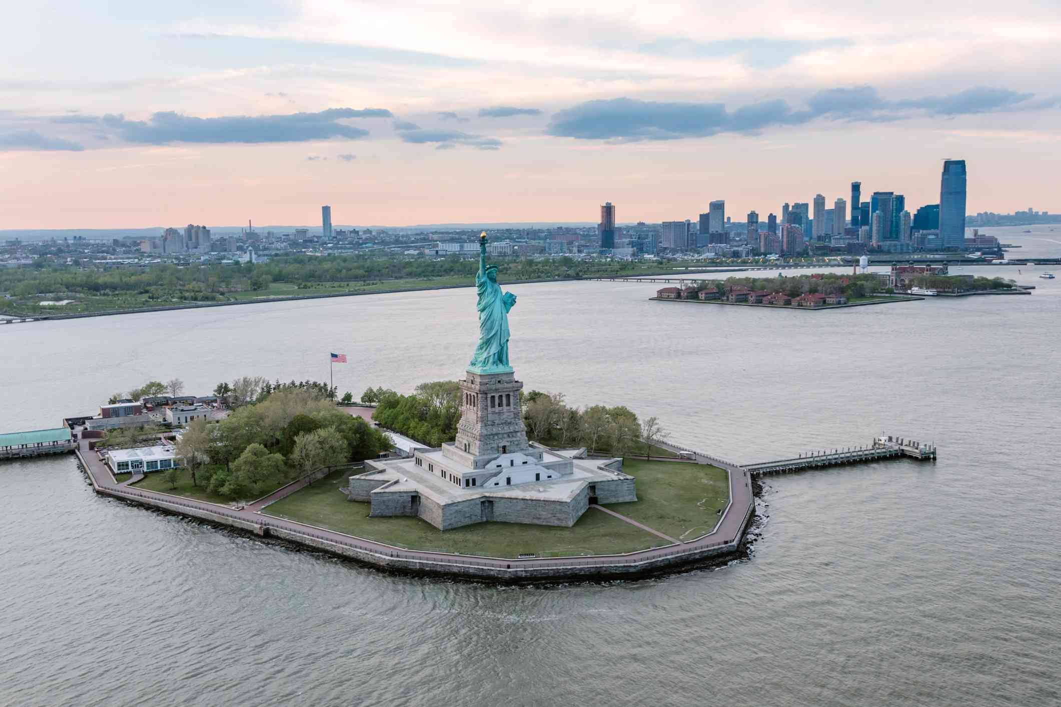 Aerial view of Liberty Island and NYC at sunset
