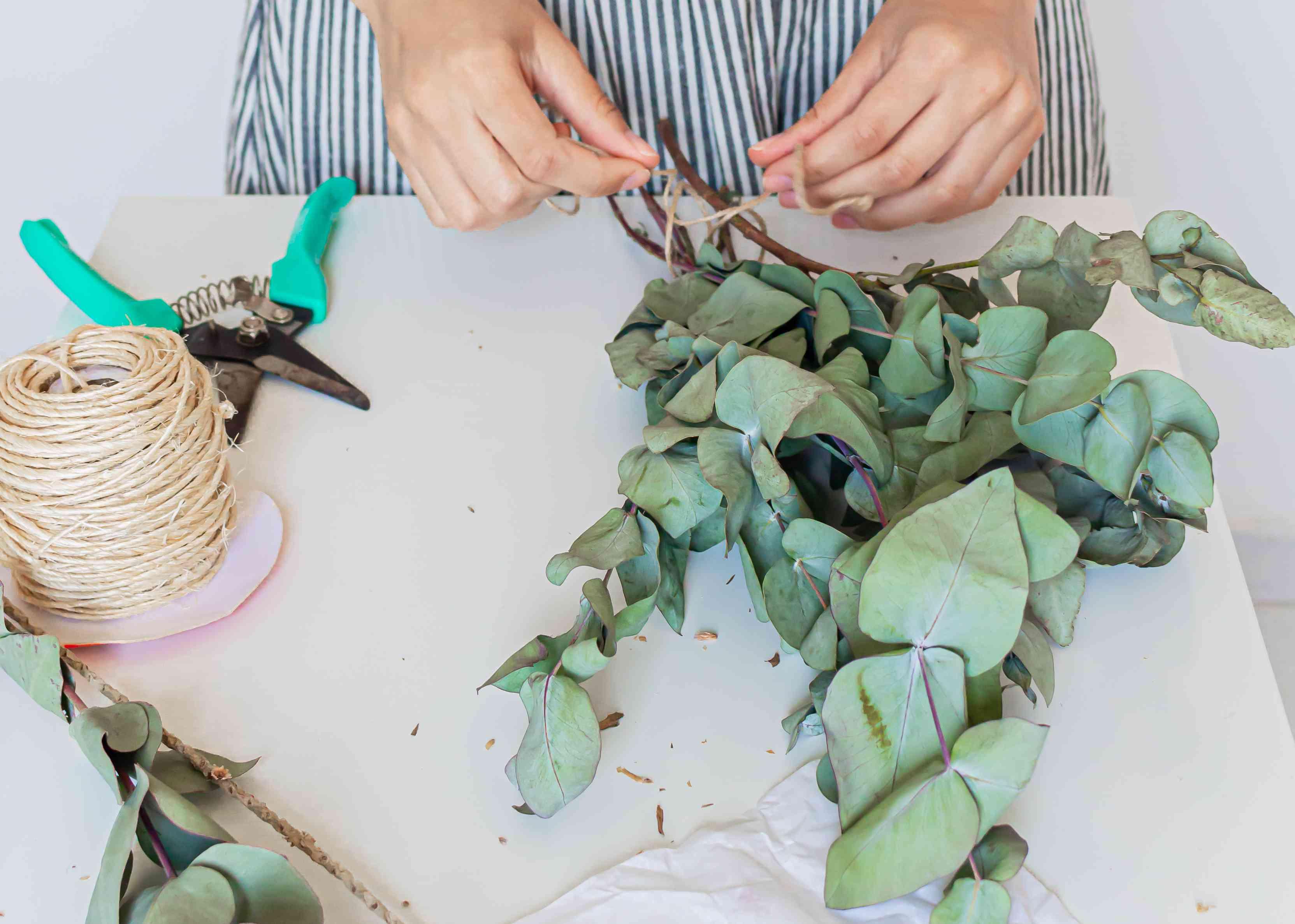 Florist making an eucalyptus bouquet