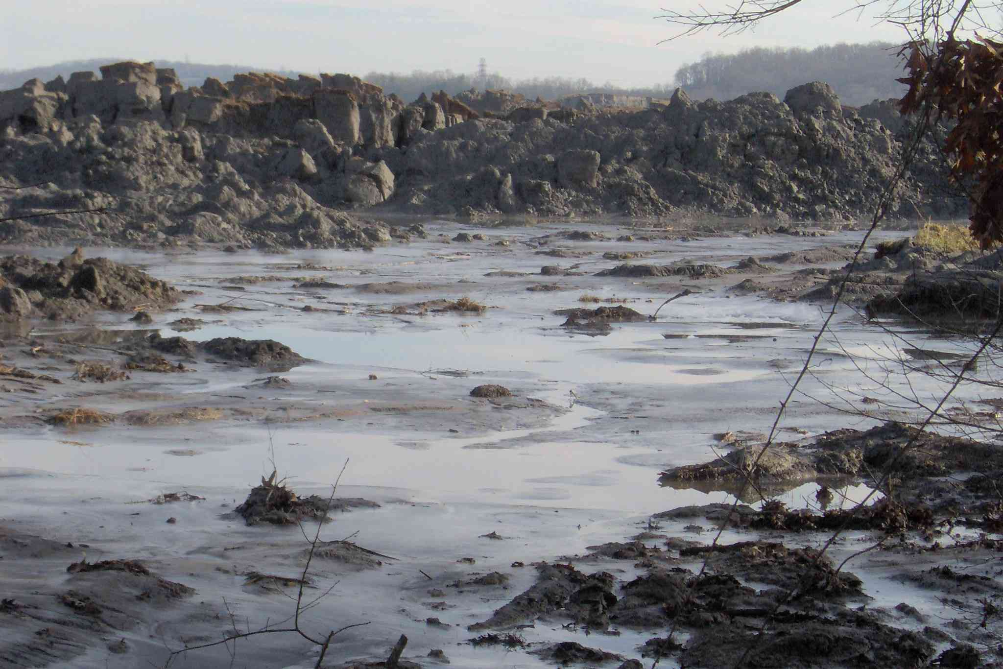 Rocky landscape covered with grey slurry of coal ash