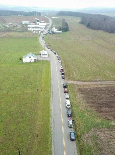 Cars in line on rural highway waiting to purchase milk from dairy