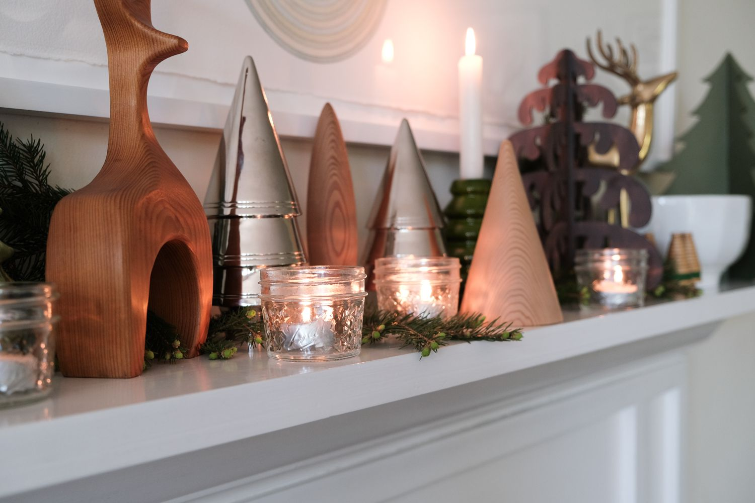 canning jars reused as tea light holders for festive holiday decor around mantle