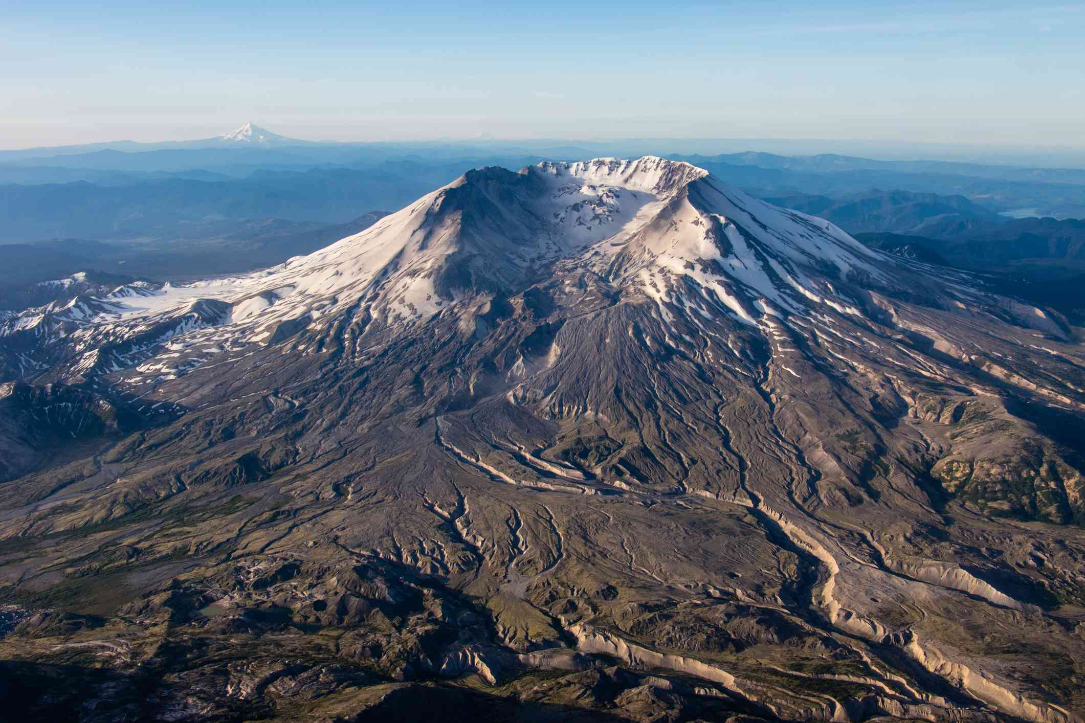 Aerial view of snowy Mount St. Helens and surrounding landscape