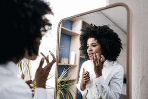 Woman applying makeup