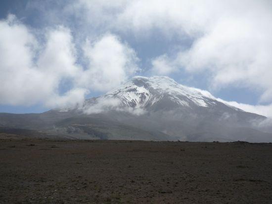 Snowy mountain against a cloudy sky