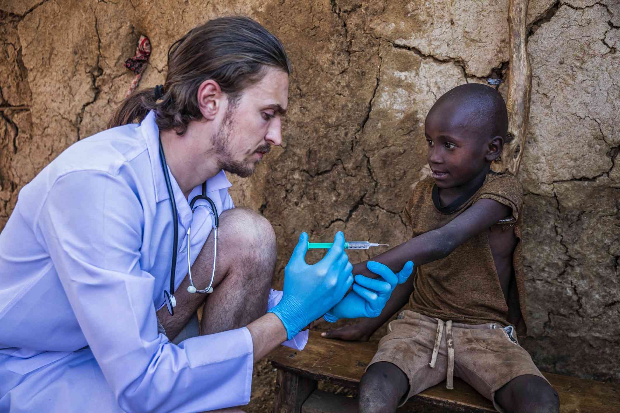 A doctor giving an injection to a boy in Kenya