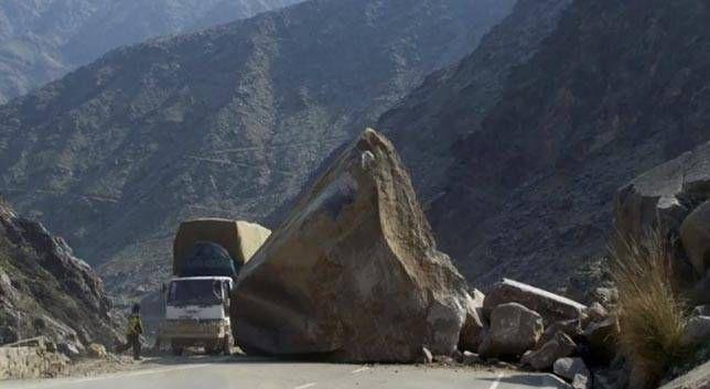 Boulder on a road